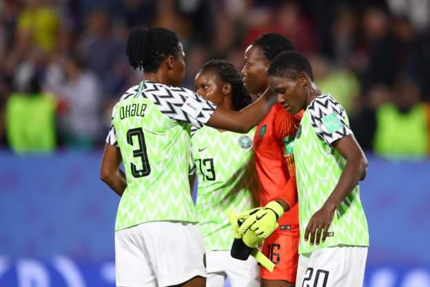 Nigeria keeper Chiamaka Nnadozie is comforted by her teammates