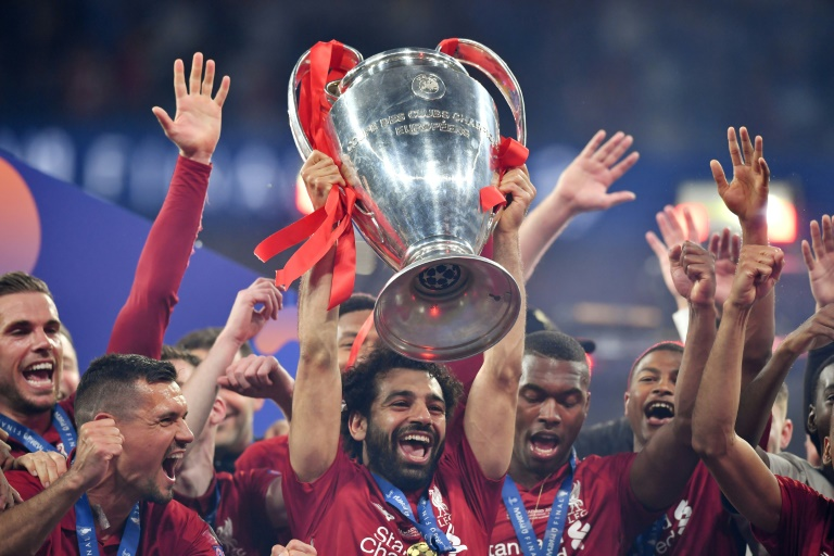 Mohamed Salah lifts the trophy after banishing the bitter disappointment of last year's final