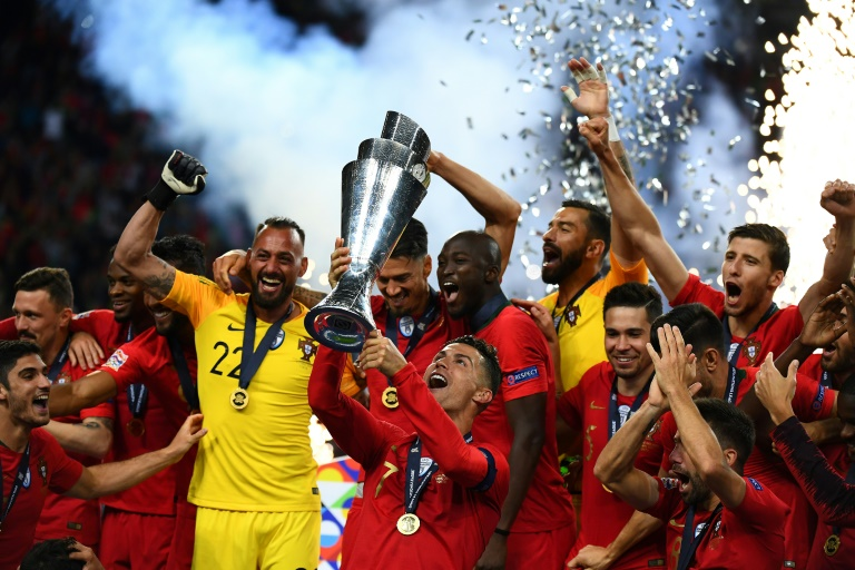 Portugal captain Cristiano Ronaldo lifts the Nations League trophy