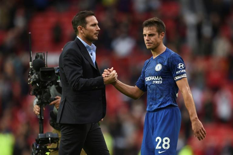 Chelsea defender Cesar Azpilicueta commiserates with Blues boss Frank Lampard