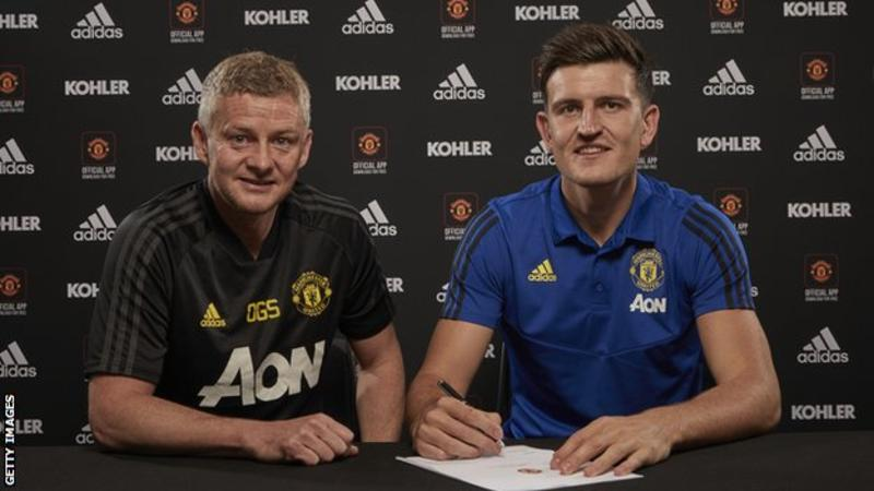 New signing, Harry Maguire with Man Utd boss Ole Gunnar Solskjaer