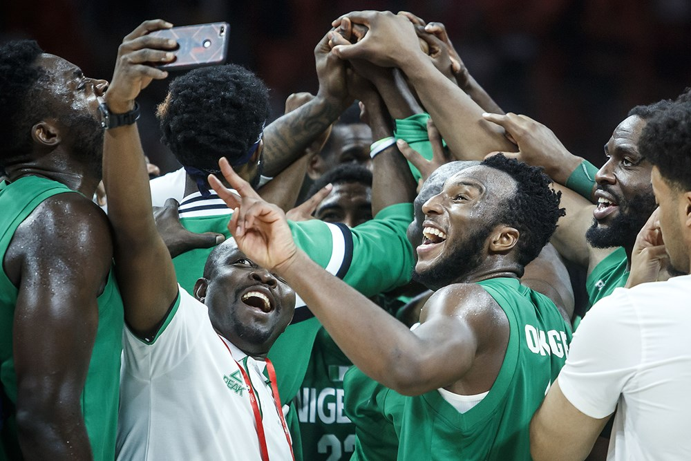D'Tigers celebrate after qualifying for the 2020 Olympic