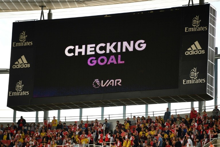 A scoreboard shows that VAR is checking a possible goal