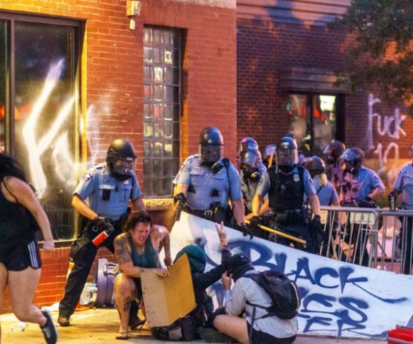 Police fire pepper spray at protesters during a demonstration over the killing of George Floyd by a policeman outside the Third Police Precinct in Minneapolis, Minnesota on May 27, 2020