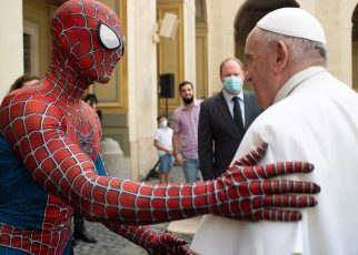 Pope Francis shakes hand with a Spider-Man impersonator, who performs for sick children